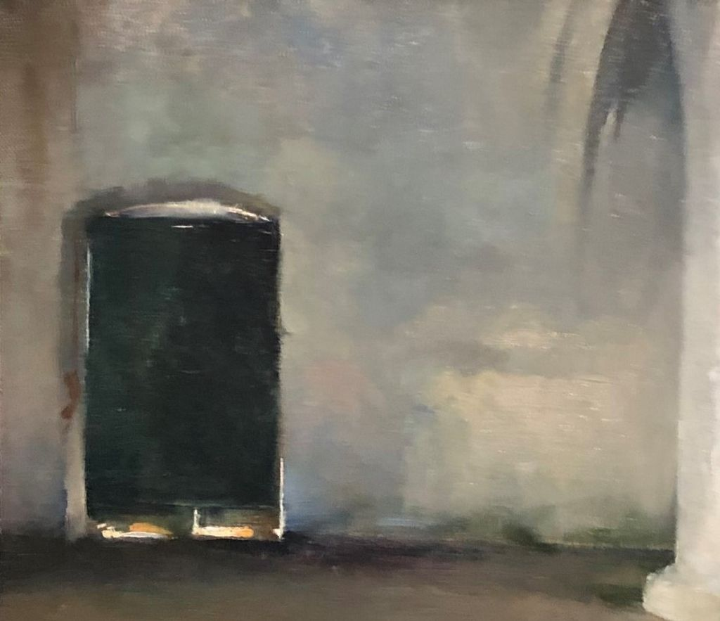 Musta ovi, jonka reunoista loistaa valoa